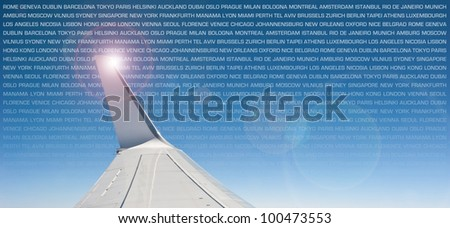 Plane wing with written towns as background.