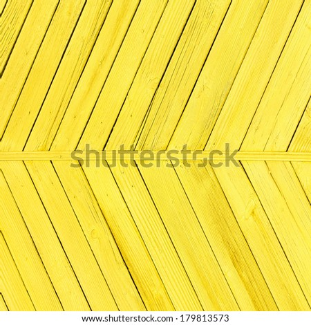 planks of wood painted bright yellow