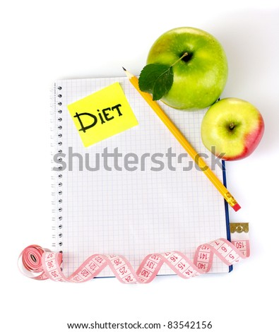 Planning of a diet. Notebook, pencil and fresh apples isolated on white