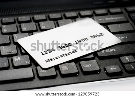 "Plastic card with an inscription ""Administrator"" on the computer keyboard"