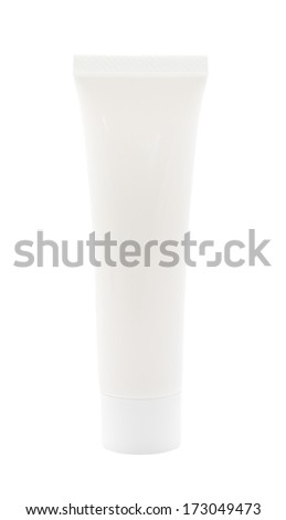 Plastic cream tube with cap on white background.