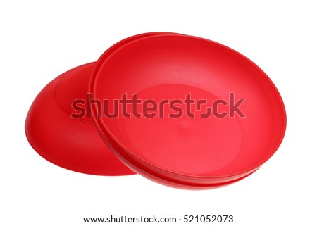 Plastic red piattis are isolated on a white background