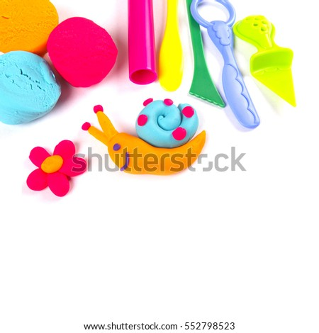 Plasticine and tools on white background