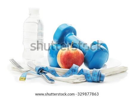 Plate, dumbbells, centimeters, knife, fork, apple and a bottle of water isolated on a white background, the concept of fitness, a healthy diet, weight loss