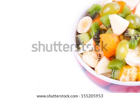Plate of a tasty cuted fruits isolated on a white.