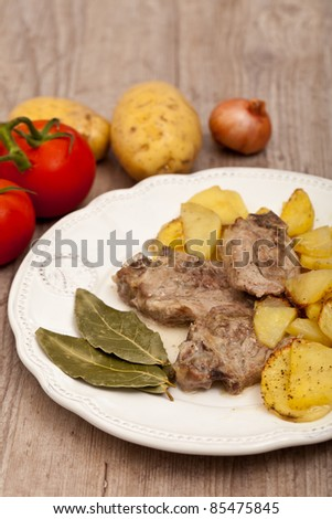 Plate of good lamb with potatoes on a white plate