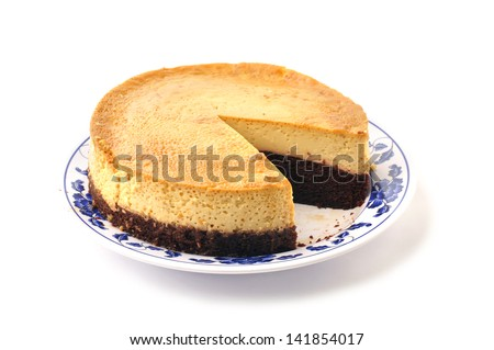 Plate of large layered chocolate and plain Mexican flan missing one ...