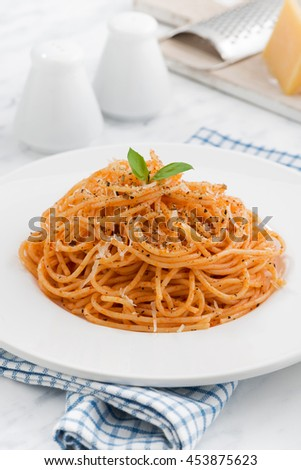 plate of pasta with tomato sauce, vertical, closeup