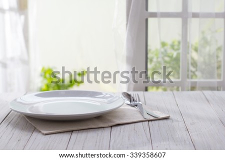 Plate on wooden background