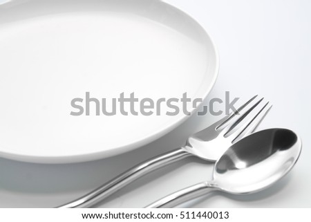 plate with fork and spoon isolated