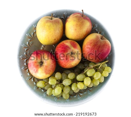 Plate with fresh fruit on a white background