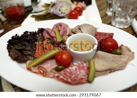 Plate with sliced meat in the pub