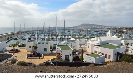 PLAYA BLANCA, LANZAROTE, SPAIN - MARCH 04, 2014:The  marina area of  Playa Blanca Lanzarote Spain with yachts and shops.
