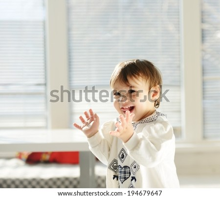 Playful baby in living room