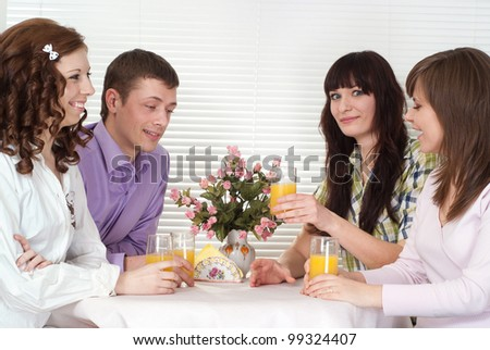 Pleasant Caucasian group of people with the juice of four sitting in a cafe
