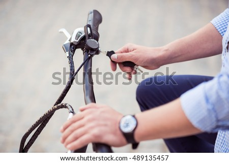 Pleasant man riding a bicycle