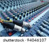 Plug and volume control knob on the panel - stock photo