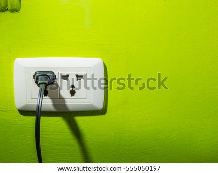 Plug socket on the wall green. Plug is needed in the home