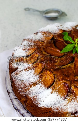 Plum cake with jelly and topped with powdered sugar