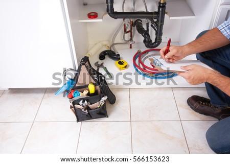 Closeup male plumber fixing sink bathroom stock photo for Bathroom renovation tools