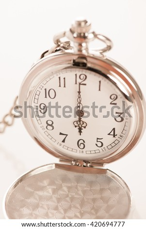 Pocket watch over white