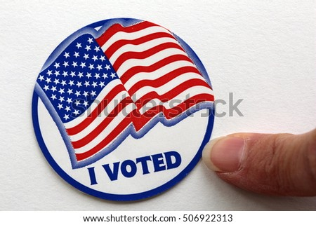 Pointing to Election I Voted Sign with USA Flag