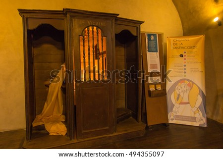 Poitiers, France - September 12, 2016: Part of the interior of the church of Saint-Porchaire in Poitiers, France. Confessional in which confessed St. Louis Monfort