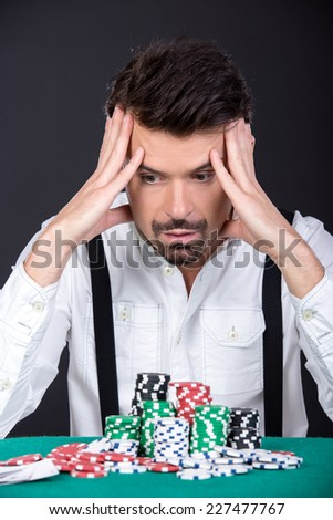 Poker player lost money in the poker game. Casino.
