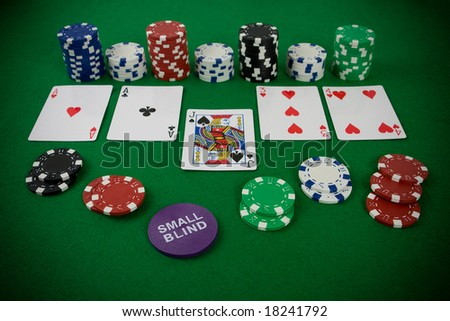 Poker Set With Chips And Cards On The Green Table   Small Blind Chip.