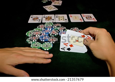 Poker table with chips and cards on it