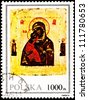 POLAND - CIRCA 1991:  A stamp printed in Poland shows a painting of the Virgin Mary holding baby Jesus with saints in the background, circa 1991. - stock photo