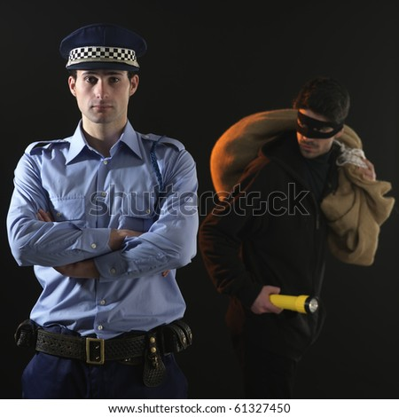 Police officer and thief. The policeman is distracted while the thief is stealing
