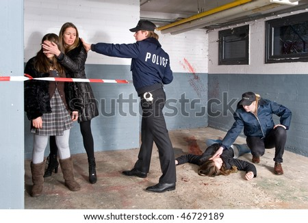 Policeman setting the perimeter of a crime scene whilst keeping the bystanders at a distance. A mother is shielding off her young daughters vision of the horrible murder that just occurred.