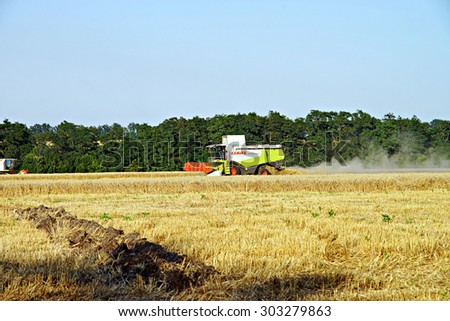 POLTAVA, UKRAINE - 04 AUGUST 2015: Combines harvested wheat. In Poltava area summer harvest in full swing.