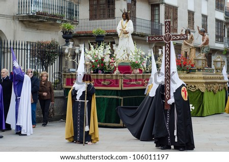 PONTEVEDRA - APRIL 5: A hooded of a cofradia in the  Catholic processions held on the occasion of Easter April 5, 2012 in Pontevedra, Galicia, Spain.