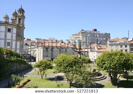 PONTEVEDRA, SPAIN - AUGUST 6, 2016: Church of the Pilgrim Virgin and other buildings in plaza in the city of Pontevedra, Galicia, Spain.