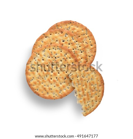 Poppy and sesame seed crackers on white background, shot from above. One cracker is broken in half