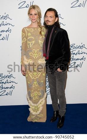 Poppy Delevigne and Matthew Williamson arriving for the 2011 British Fashion Awards, at The Savoy, London. 28/11/2011 Picture by: Simon Burchell / Featureflash