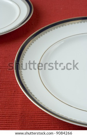 porcelain plates in a perspective over red (selective and soft focus)