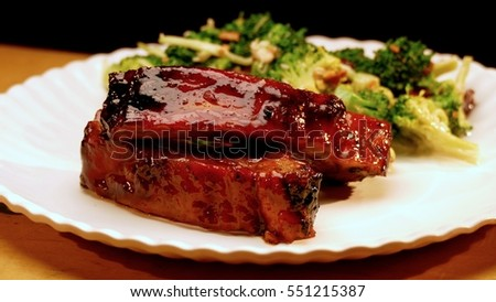 Pork ribs with BBQ sauce on a plate