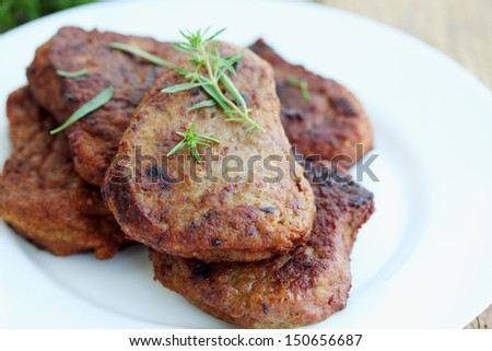Pork schnitzel with fresh savory on plate