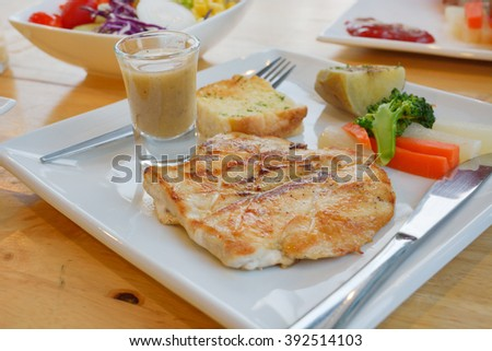 pork steak with vegetable on a plate