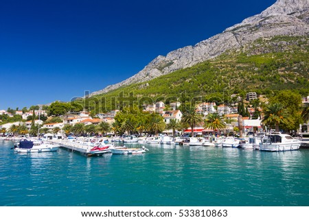 Port and mountains behind in Baska Voda, Croatia