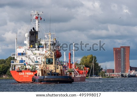 Port of Amsterdam, Noord-Holland/Netherlands - October 09-10-2016 - Tanker Gas Pasha is sailing to the terminal. The ship is receiving tugboat assistance for a safe navigation.