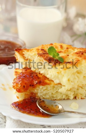 Portion of cottage cheese casserole with orange jam