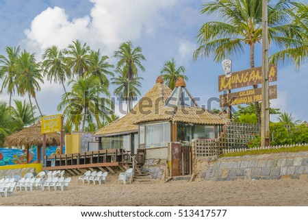 PORTO GALINHAS, BRAZIL, JANUARY - 2016 - Rustic style waterfront restaurant at tropical beach in Porto Galinhas, Pernambuco, Brazil