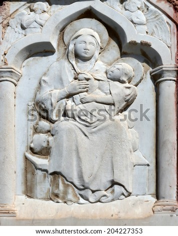 PORTOFINO,ITALY - MAY 04,2014:Madonna with Child and Saints,relief at house,Portofino is an Italian fishing village famous for its picturesque harbor and historical association with celebrity visitors
