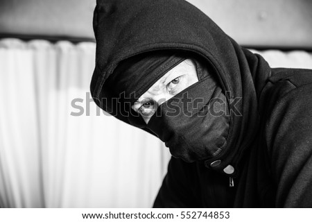 Portrait man in black mask evil criminal,Dangerous man ,Crime concept