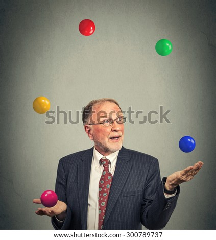 Portrait mature business man juggling multitasking