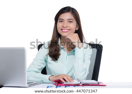 Portrait of a attractive asian business woman at desk.